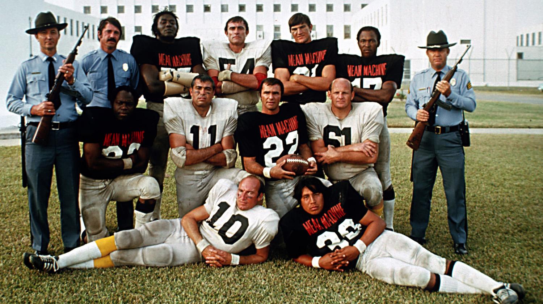 Burt Reynolds and cast of The Longest Yard