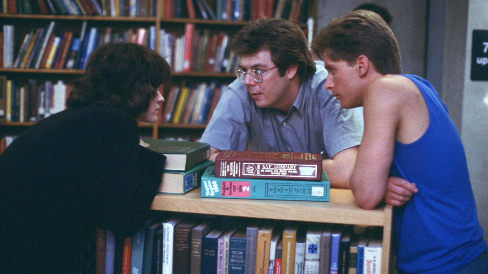 John Hughes with Ally Sheedy and Emilio Estevez on the set of The Breakfast Club