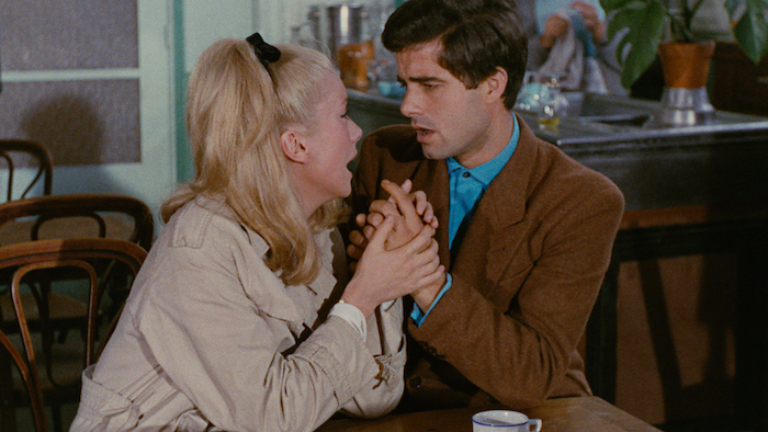 Catherine Deneuve and Nino Castelnuovo sing and embrace in The Umbrellas of Cherbourg