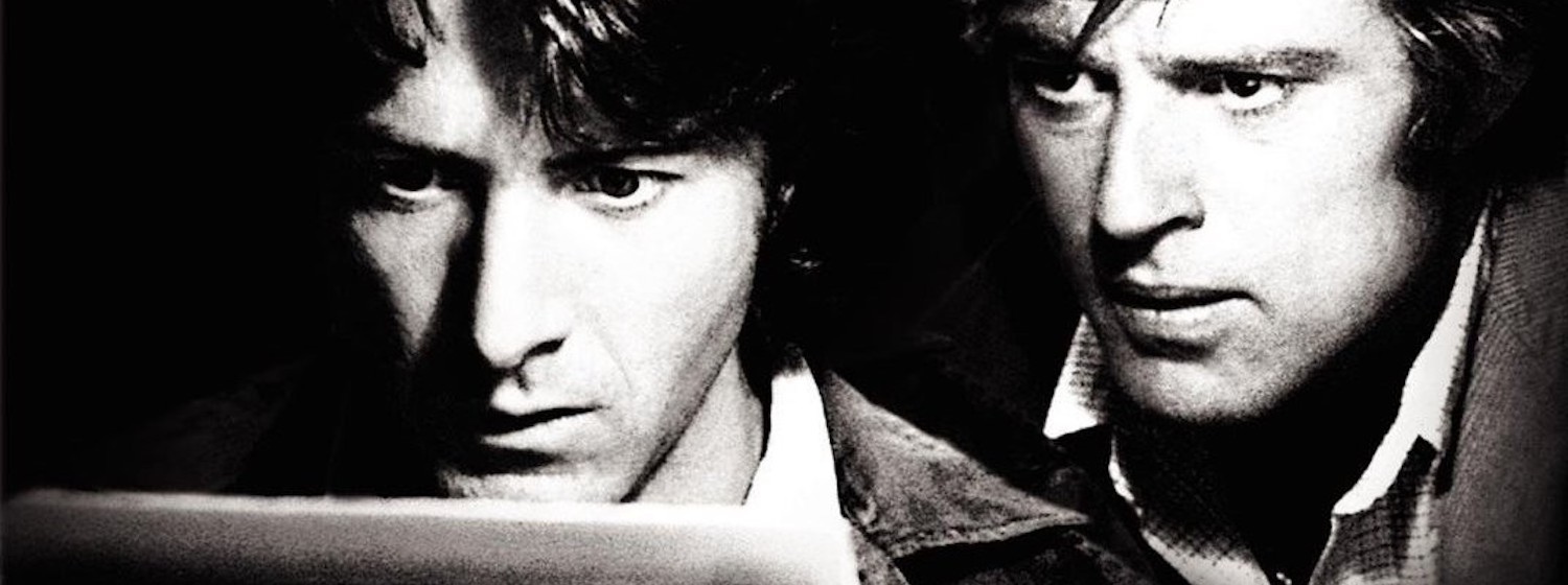 Robert Redford as Bob Woodward and Dustin Hoffman as Carl Bernstein sit at a typewriter in All the President's Men