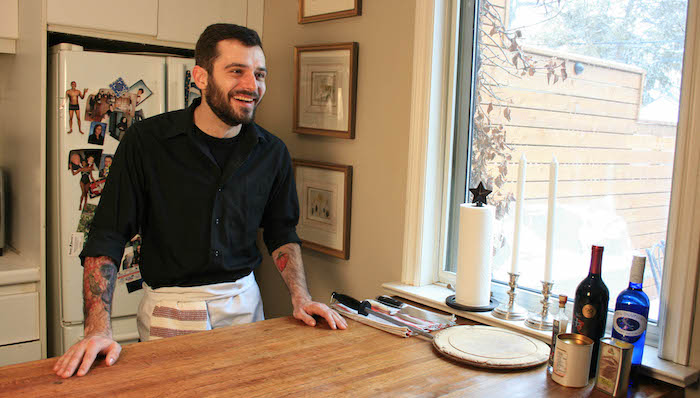 Chef Eric Wallis stands at the counter in his home kitchen.