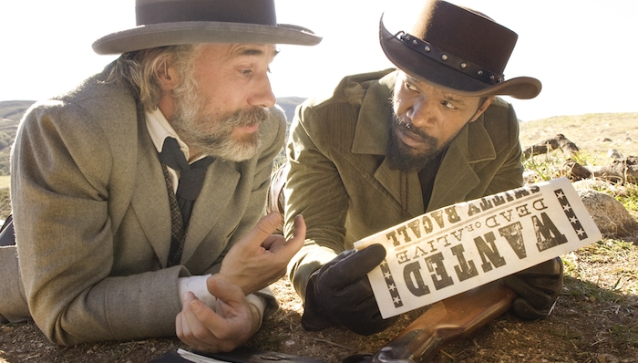 Christoph Waltz and Jamie Foxx look at a wanted poster in Django Unchained