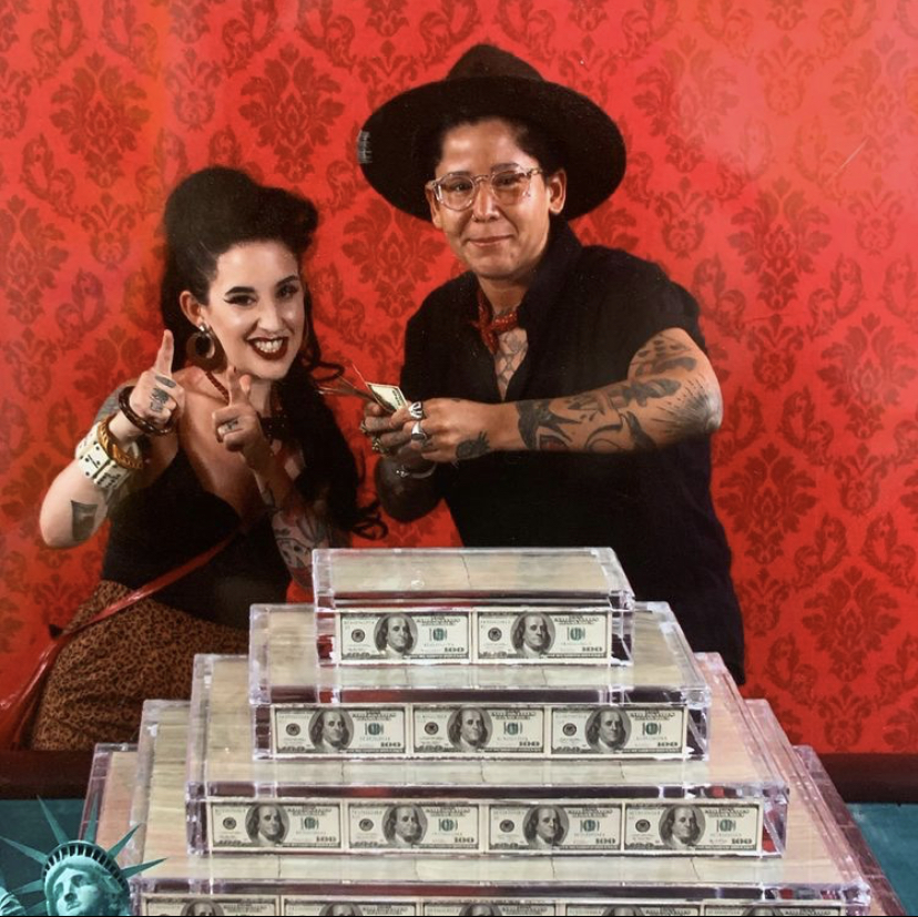Alana Nogueda and Aviva Rosnick of Toronto's Las Vegas-inspired restaurant Legal Tenders pose with stacks of US currency