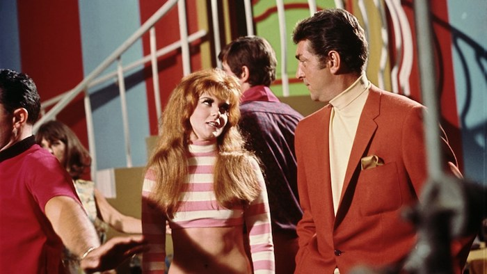 Dean Martin and Ann-Margret appear in a brightly-coloured club scene in Murderers' Row (1968)