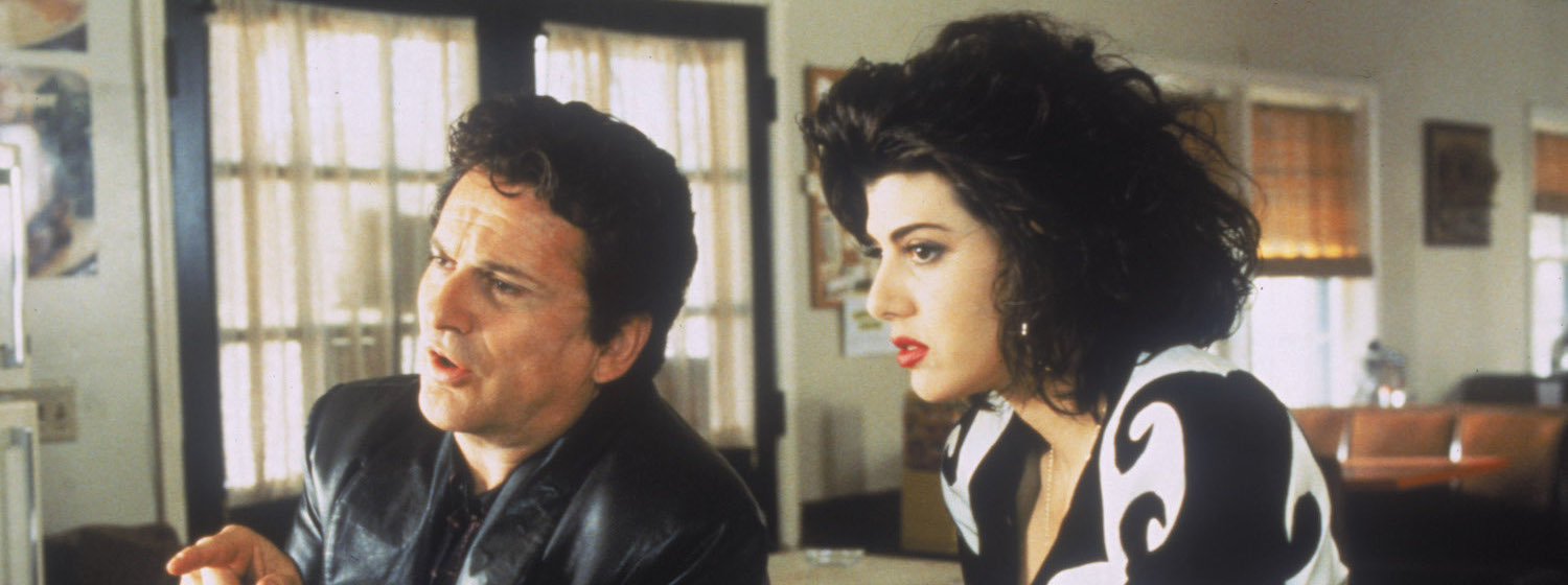 Joe Pesci and Marissa Tomei sit at the counter in a diner in My Cousin Vinny (1992)