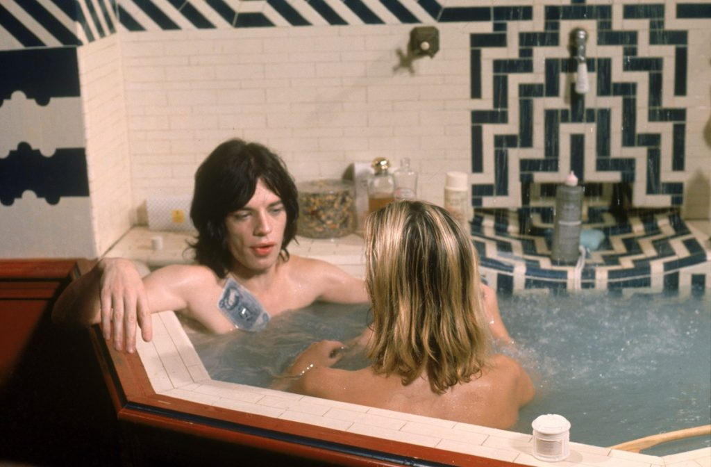 Mick Jagger and Anita Pallenberg share a bath in Performance