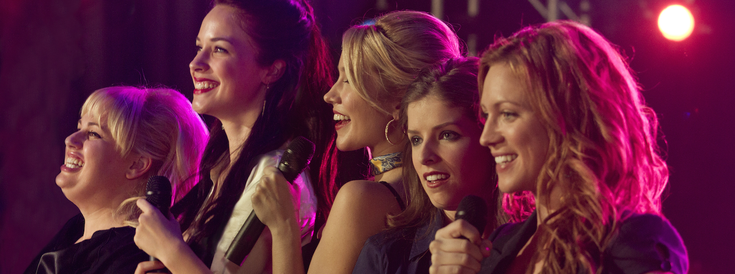 The cast of Pitch Perfect performing on stage