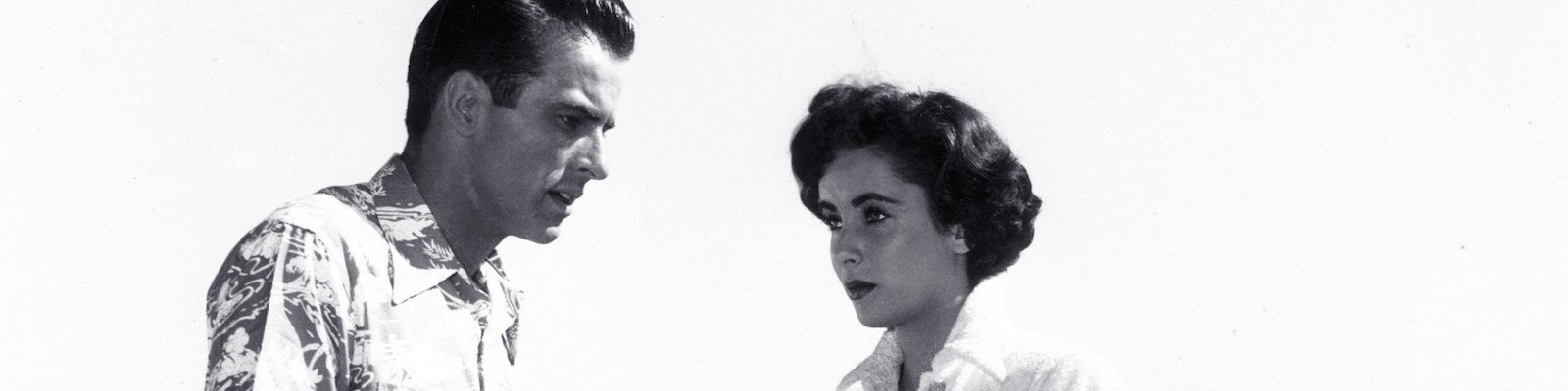 Montgomery Clift and Elizabeth Taylor look into each other's eyes