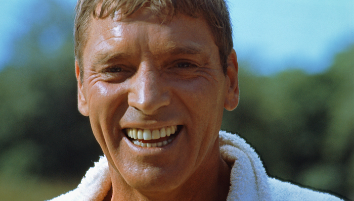 Burt Lancaster smiles in a close up in The Swimmer (1968)