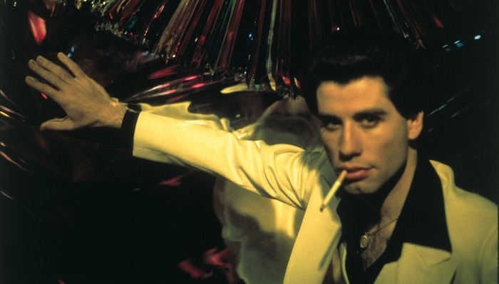 John Travolta in front of a mirrored wall in Saturday Night Fever
