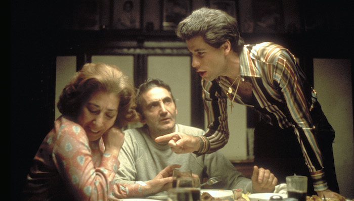 Tony Manero (John Travolta) argues with his parents at their dinner table in Saturday Night Fever