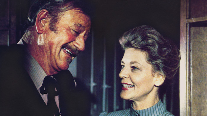 John Wayne and Lauren Bacall in The Shootist