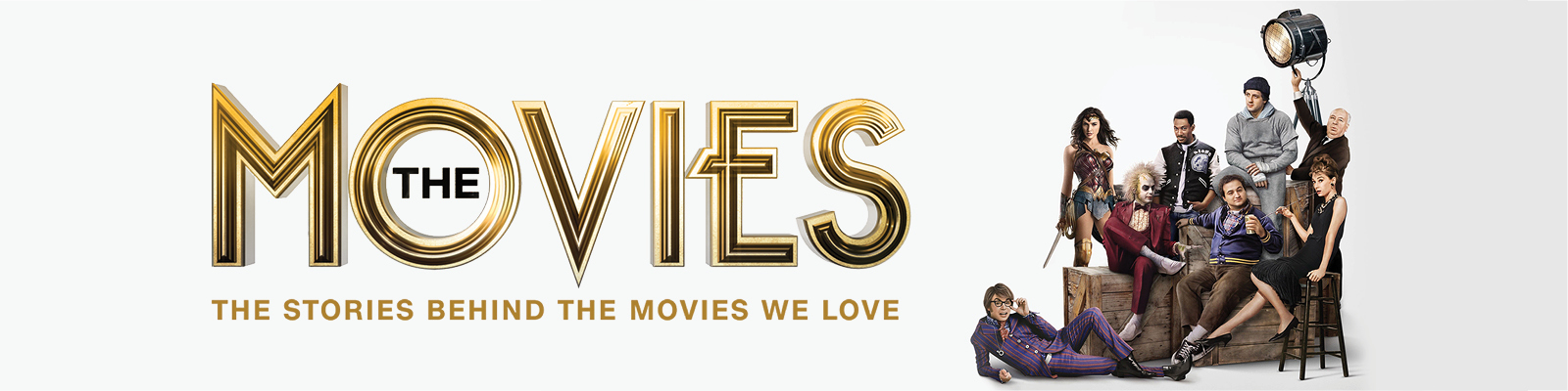 Assorted classic movie characters stand together against a white soundstage background with the words