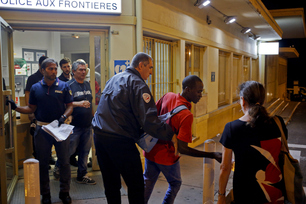A Black person is detained at a French border post