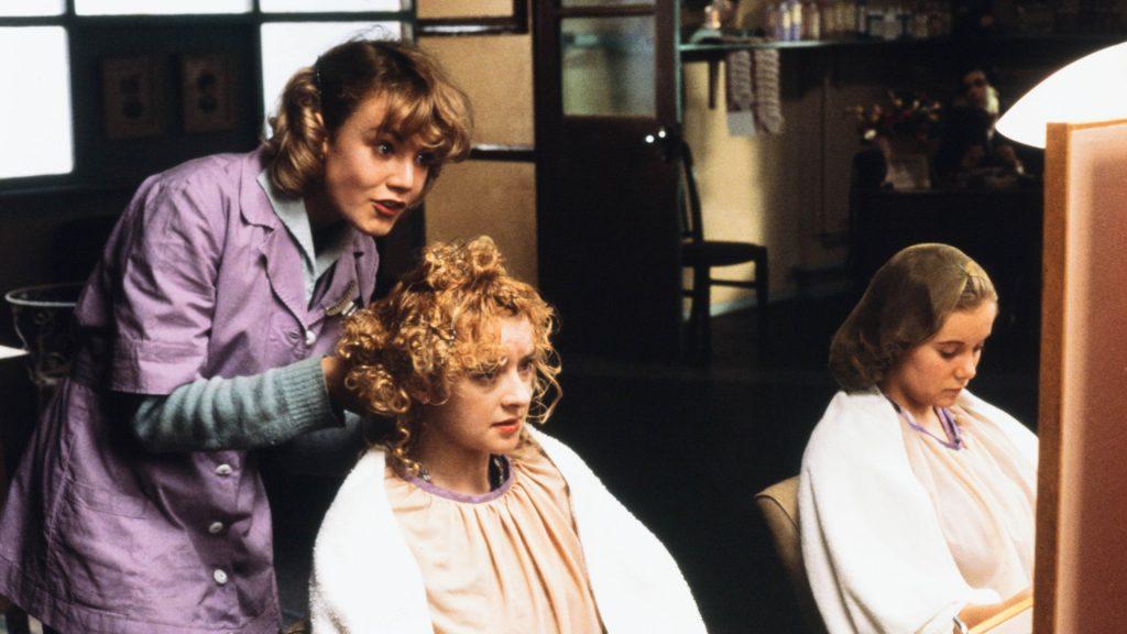 Emily Lloyd works as a hair dresser in Wish You Were Here