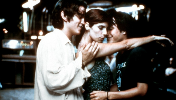 Diego Luna, Gael García Bernal, and Maribel Verdú dance in a close, sexual embrace in Y Tu Mamá También