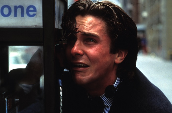 Christian Bale as Patrick Bateman cries into a payphone in American Psycho
