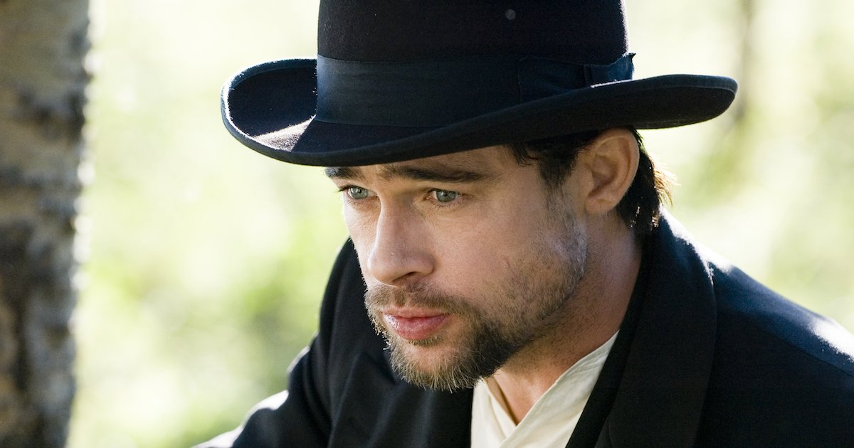 Close up of Brad Pitt with a beard, wearing in a period hat in The Assassination of Jesse James by the Coward Robert Ford
