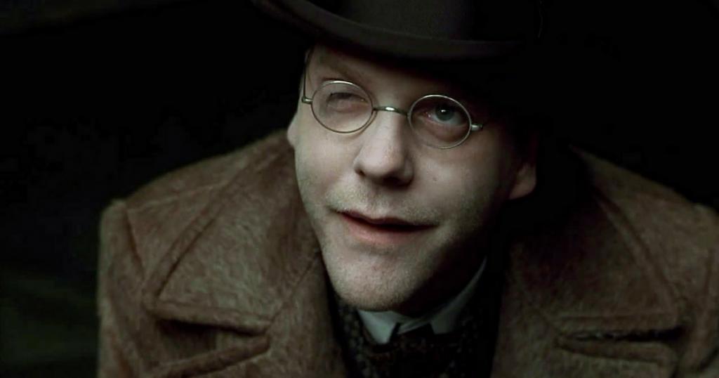 Close up of a smirking Dr. Schreber (Kiefer Sutherland) in Dark City