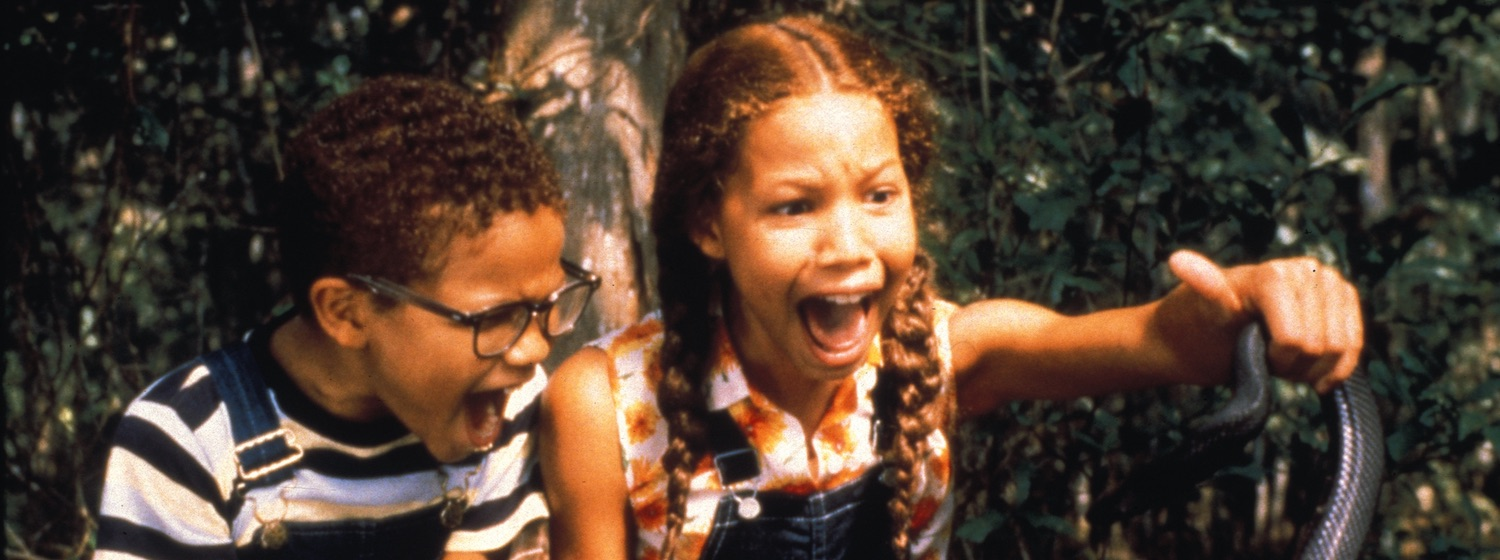 Eve Baptiste (Jurnee Smollett) and a young friend scream upon finding a snake in Eve's Bayou