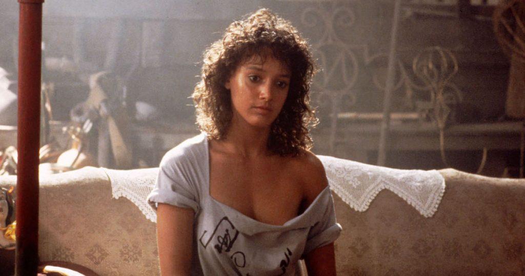 Jennifer Beals wears a off the shoulder shirt in Flashdance