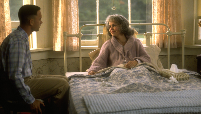Tom Hanks sits at the bedside of his mother played by Sally Field in Forrest Gump