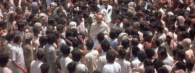 Ben Kingsley as Gandhi walks through a crowd