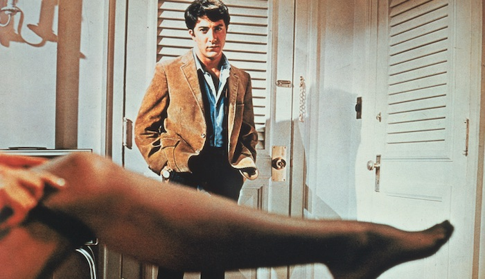 Benjamin Braddock (Dustin Hoffman) looks at Mrs. Robinson's outstretched leg (Anne Bancroft) in The Graduate