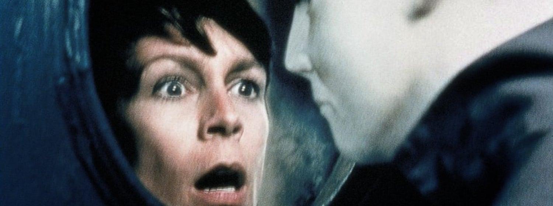 Jamie Lee Curtis looks through a window in terror at Michael in Halloween H20
