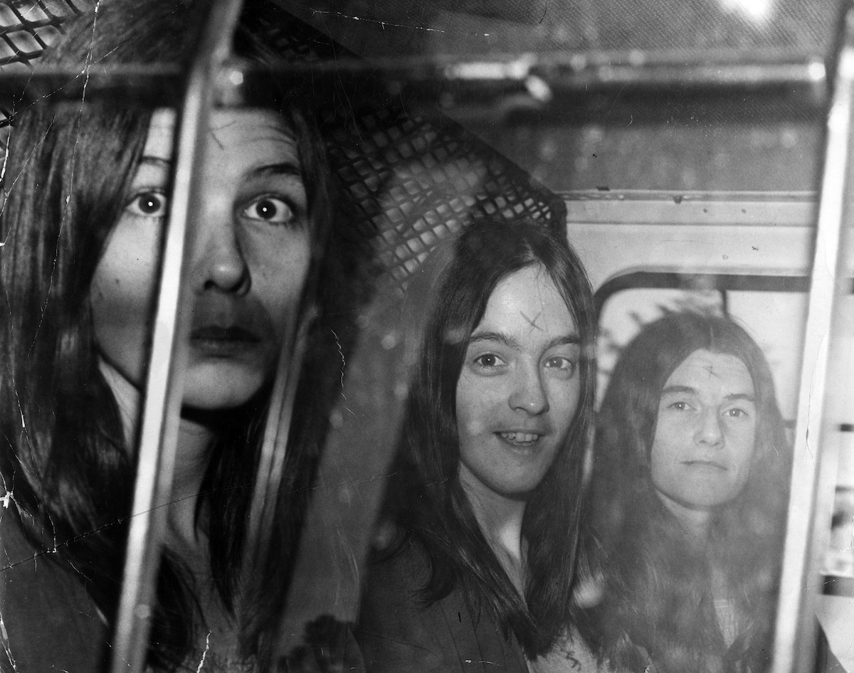 Followers of Charles Manson are transported in a police vehicle