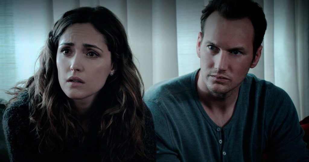 Rose Byrne and Patrick Wilson sit together in Insidious.