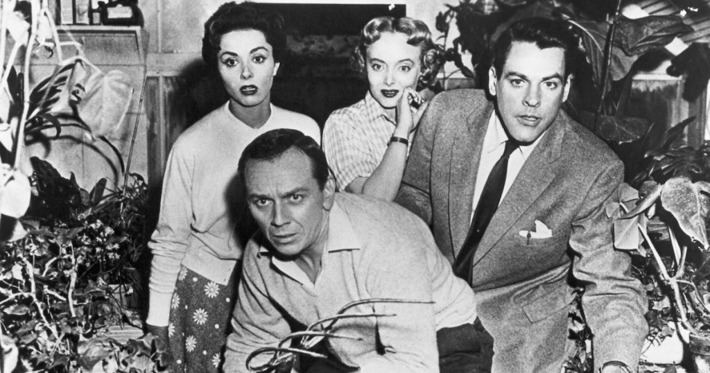 terrified townsfolk use a pitchfork to fend off the podpeople in Invasion of the Body Snatchers 1956