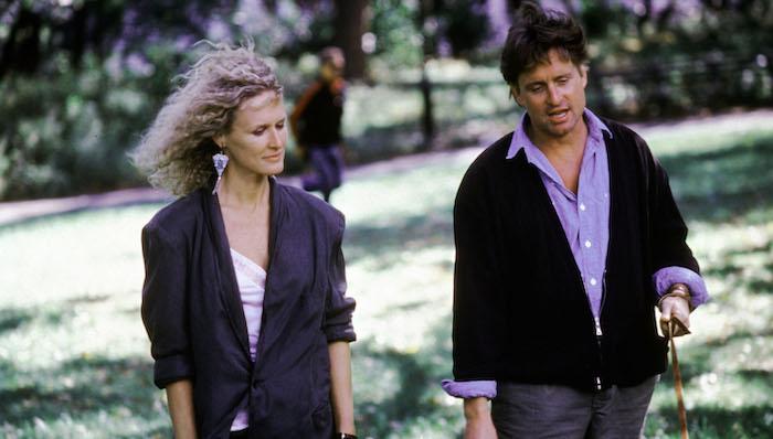 Glenn Close and Michael Douglas walk in a park in Fatal Attraction