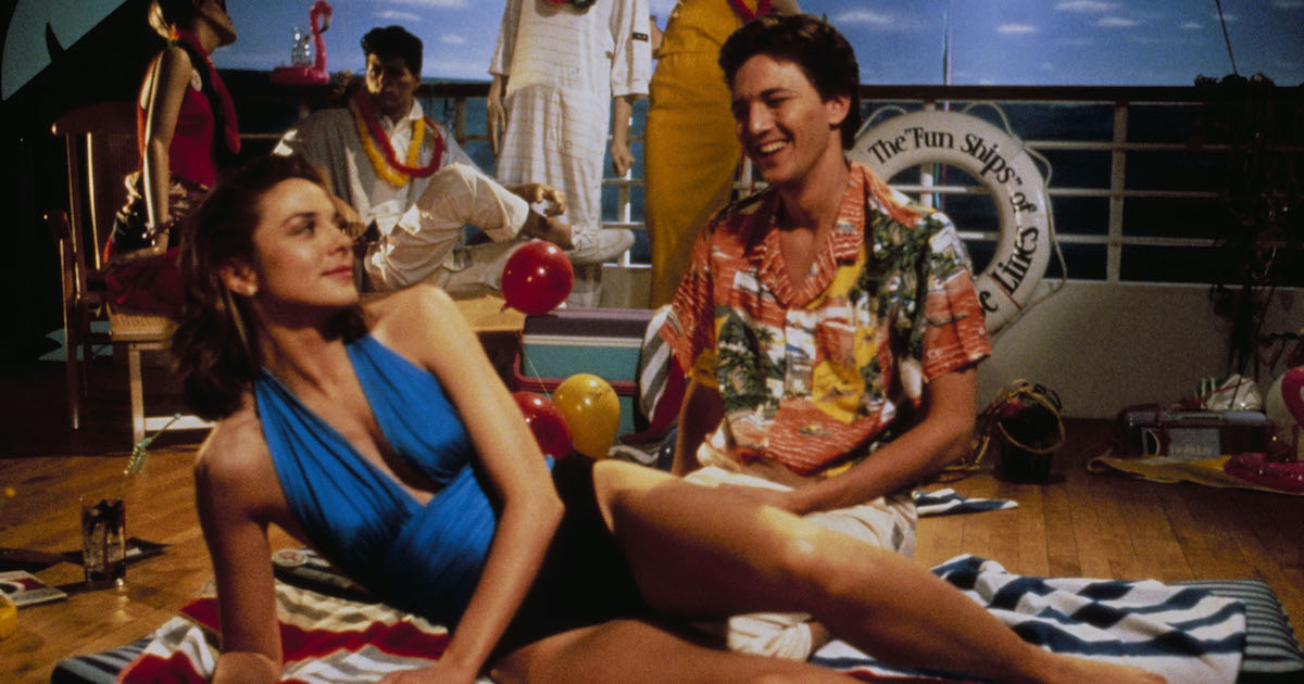 Kim Cattrall and Andrew McCarthy pose in a nautical-themed department store widow in Mannequin (1987)