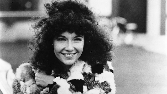 Mary Steenburgen smiles in a close up image from the film Melvin and Howard