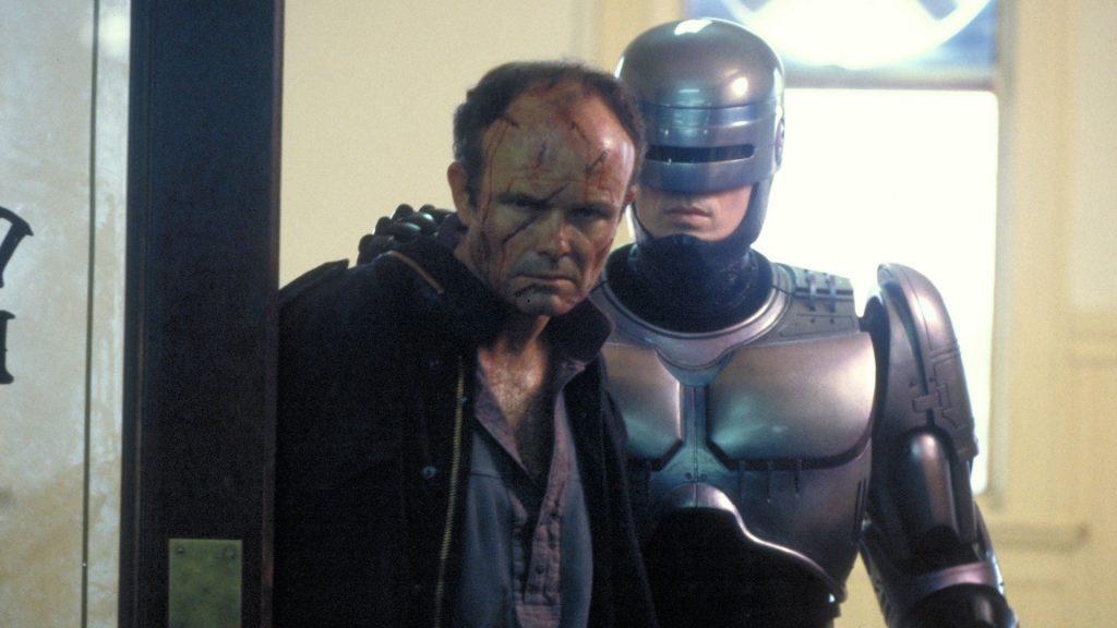 Peter Weller as Robocop arrests a criminal played by Kurtwood Smith in Robocop