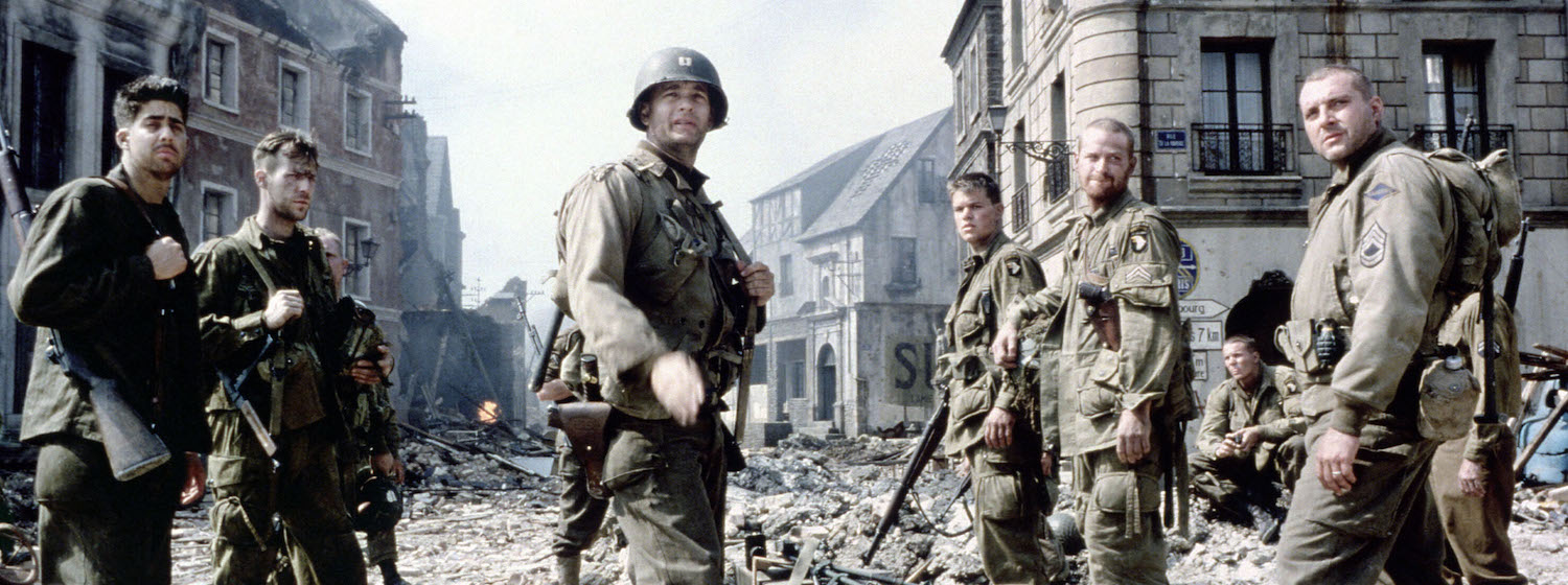 The ensemble cast of Saving Private Ryan stands amongst the ruins of a bombed town