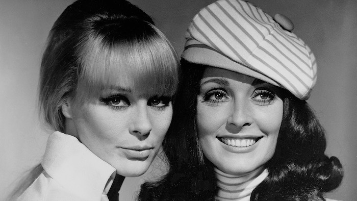 Elke Sommer and Sharon Tate pose for a black and white publicity photo for The Wrecking Crew (1968)